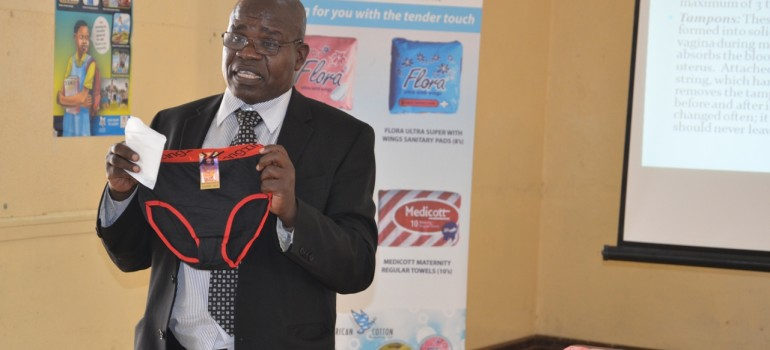 A teacher demonstrates the use of sanitary towels during Nairobi County training